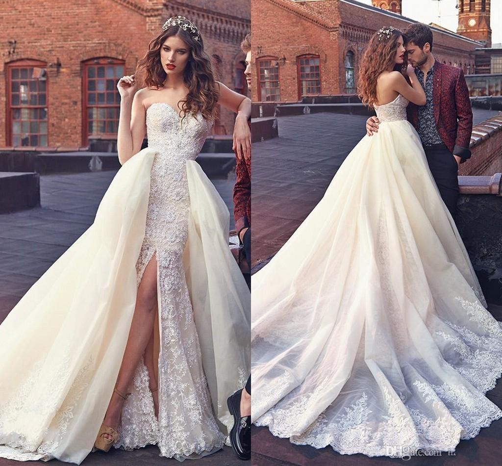 Váy cưới đuôi cá xẻ chân ren nguyên tấm