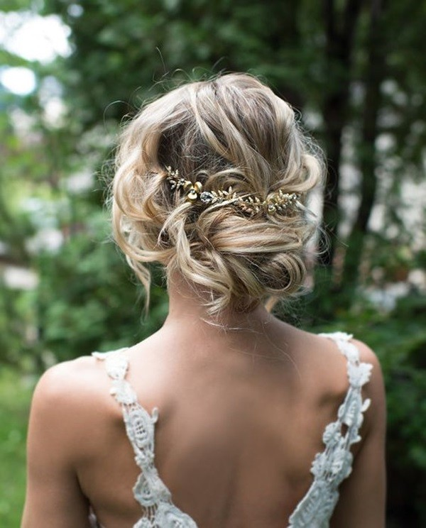 Chic-Twisted-Low-Bun-Wedding-Hairstyle-with-Gold-Leaf-Hair-Crown